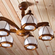 Wooden chandelier on the ceiling — Stock Photo