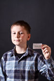 Boy shows a card with gratitude — Stock Photo