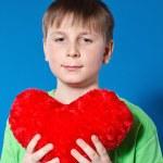 Boy holding a heart — Stock Photo #18971619