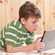Boy teenager with tablet computer — Stock Photo #18972339