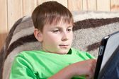 Boy teenager with tablet computer — Stock Photo
