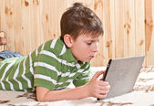 Boy teenager with tablet computer — Stockfoto