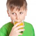 Boy drinking juice — Stock Photo