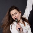 Girl singing into a microphone — Stock Photo #19281891