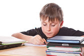 Schoolchild learns lessons — Stock Photo