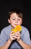 Boy with orange juice — Stock Photo
