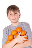 Happy boy with tangerines — Stock Photo