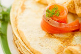 Pancakes with salted salmon — Stock Photo