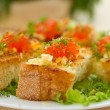Fried toast with cheese and red caviar — Stock Photo