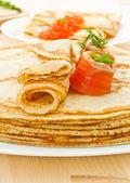 Pancakes with salted salmon — Stock Photo