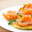 Potato pancakes with salted salmon — Stock Photo