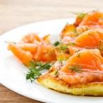 Potato pancakes with salted salmon — Stock Photo