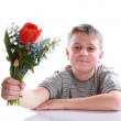 Happy teenager with bouquet of flowers — Stock Photo #24703683