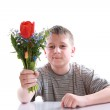 Happy teenager with bouquet of flowers — Stock Photo #24714191