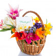 Bouquet of flowers in a basket — Stock Photo #24838737