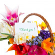 Bouquet of flowers in a basket — Stock Photo