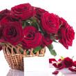 Roses in a wicker basket — Stock Photo #24987835
