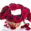 Roses in a wicker basket — Stock Photo