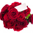 Bouquet of red roses with a blank — Stock Photo