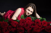 Beautiful girl with roses — Stock Photo