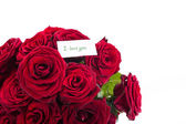 Red roses with a declaration of love — Stock Photo