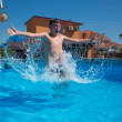 Boy jumping in pool — Foto Stock #25294583