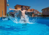 Boy jumping in the pool — Stock Photo