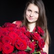 Stock Photo: Beautiful girl with roses