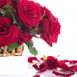 Roses in a wicker basket — Stock Photo #25698573
