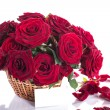 Roses in a wicker basket — Stock Photo #25698575