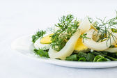 Salad with squid and eggs — Stock Photo
