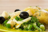 Green salad with onion and squid — Stock Photo