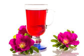 Tea with rose hips with flowers — Stock Photo