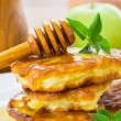 Pancakes with apples and honey — Stock Photo #29640205