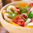 Salad with tomatoes and squid — Stock Photo