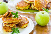 Pancakes with apples and honey — Stock Photo
