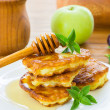 Pancakes with apples and honey — Stock Photo #30242253