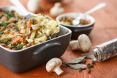 Baked potato with mushrooms and cheese — Stock Photo
