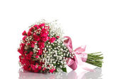 Bouquet of red roses with ribbon — Stock Photo