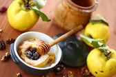 Baked quince with walnuts and honey — Stock Photo