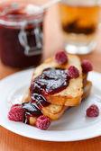 Toast with raspberry jam — Stock Photo