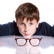 Boy with glasses and low vision — Stock Photo #33488595