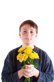 Boy with a bouquet of roses — Stock Photo