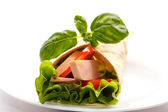 Pita bread with lettuce, salami and tomatoes — Stock Photo