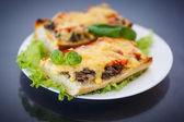 Bruschetta with mushrooms and cheese — Stock Photo