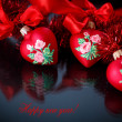 Stock Photo: Christmas red hearts with red garland