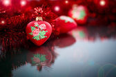 Christmas red hearts with red garland — Stock Photo