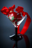 Christmas red hearts in a glass — Stock Photo