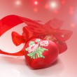 Decorative red heart with ribbon — Stock Photo #36020103