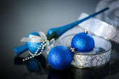 Christmas card with blue balls and ribbon — Stock Photo